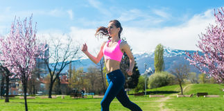 Woman running fast for sport on sunny day Stock Image