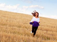 A woman is running through the field Royalty Free Stock Images