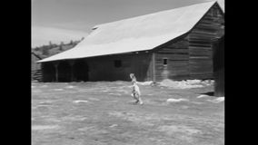 Woman running on field stock video footage
