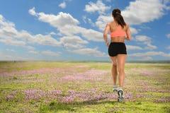 Woman Running on Field Stock Photos