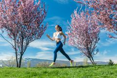 Woman running for fitness on a spring day stock images
