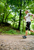 Woman running in forest Royalty Free Stock Photo