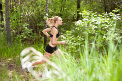 Woman running in the forest Royalty Free Stock Image