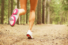 Woman running in the forest Stock Photo