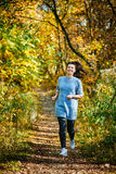 Woman running in forest Royalty Free Stock Photos