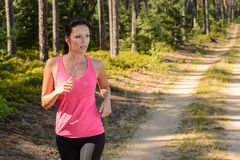 Woman running through forest outdoor training stock photography
