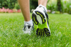 Woman running on grass Royalty Free Stock Image