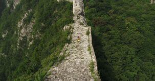 Woman running on great wall. Woman runner running on great wall stock video