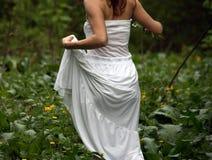 Woman running in green field Stock Photos