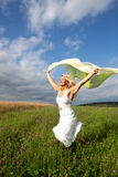 Woman is running on a green meadow Stock Photo