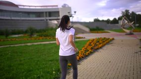 Young beautiful woman is running in the park. slow-motion stock footage
