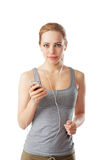 Woman running with head phones on Stock Image