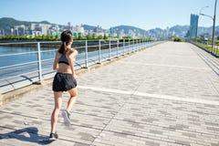 Woman running in Hong Kong Stock Photography