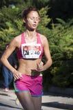 Woman running (Hunger Run 2014, FAO/WFP) Stock Photo
