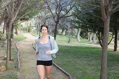 Woman running or jogging Stock Photos