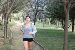 Woman running or jogging Stock Photos