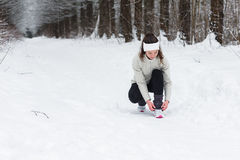 Woman running jogging in the winter forest Royalty Free Stock Image