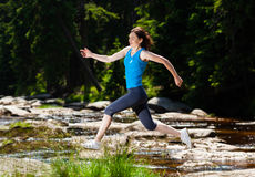 Woman running, jumping Royalty Free Stock Image