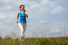 Woman running, jumping Royalty Free Stock Images