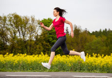 Woman running, jumping Royalty Free Stock Photos