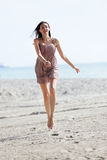 Woman running and jumping Royalty Free Stock Photos