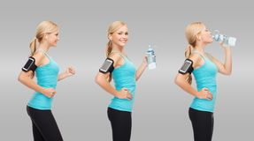 Woman running, listening music and drinking water Stock Image
