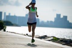 Woman running and listening music stock photo