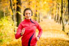 Woman running and listening music Royalty Free Stock Image