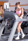 Woman on running machine in gym Royalty Free Stock Image