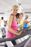 Woman On Running Machine In Gym Stock Photo