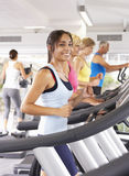 Woman On Running Machine In Gym Stock Image