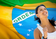 Woman running a marathon in Brazil Stock Images