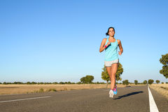 Woman running for marathon Royalty Free Stock Photography