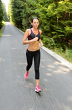 Woman running marathon race motion blur Royalty Free Stock Photography