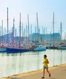 Woman running at marina. Barcelona Royalty Free Stock Image