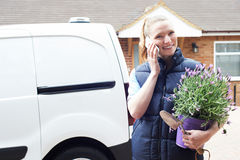 Woman Running Mobile Gardening Business Using Mobile Phone. Woman Running Mobile Gardening Business Uses Mobile Phone Royalty Free Stock Images