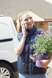 Woman Running Mobile Gardening Business Using Mobile Phone. Woman Runs Mobile Gardening Business Using Mobile Phone Stock Photos