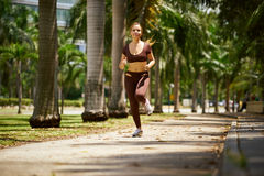 Woman Running At Morning In The City Royalty Free Stock Photo
