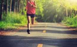woman running at morning tropical forest trail Royalty Free Stock Photos