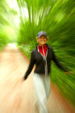 Woman running with motion blur. Stock Image