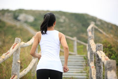 Woman running at mountain stairs Royalty Free Stock Photography