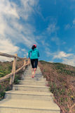 Woman running on mountain stairs Stock Photo