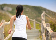 Woman running at mountain stairs Royalty Free Stock Images