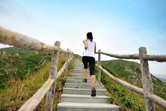 Woman running at mountain stairs Royalty Free Stock Image