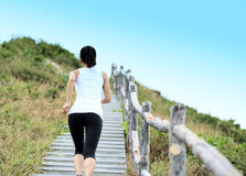 Woman running at mountain Stock Photography