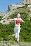 Woman running at the mountains Royalty Free Stock Image