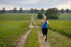 Woman running in nature. Blonde woman running in nature Stock Photos