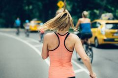 Woman running on New York City Central Park at the morning. Royalty Free Stock Photos