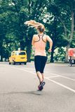 Woman running on New York City Central Park at the morning. Stock Images