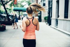 Woman running on New York City street at the morning. Stock Image